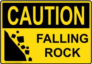 Sign that reads, Caution Falling Rock