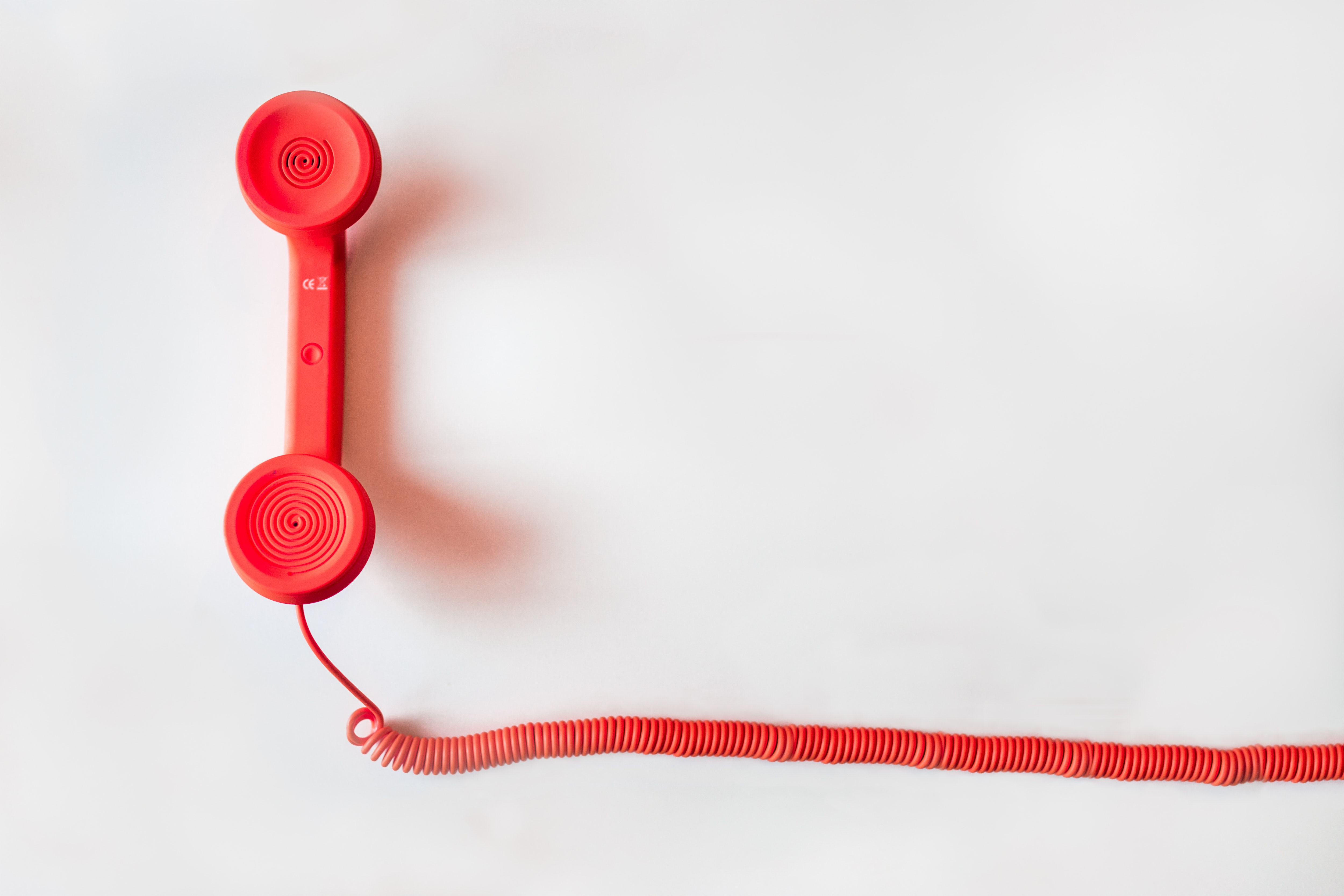 Red, wired telephone.